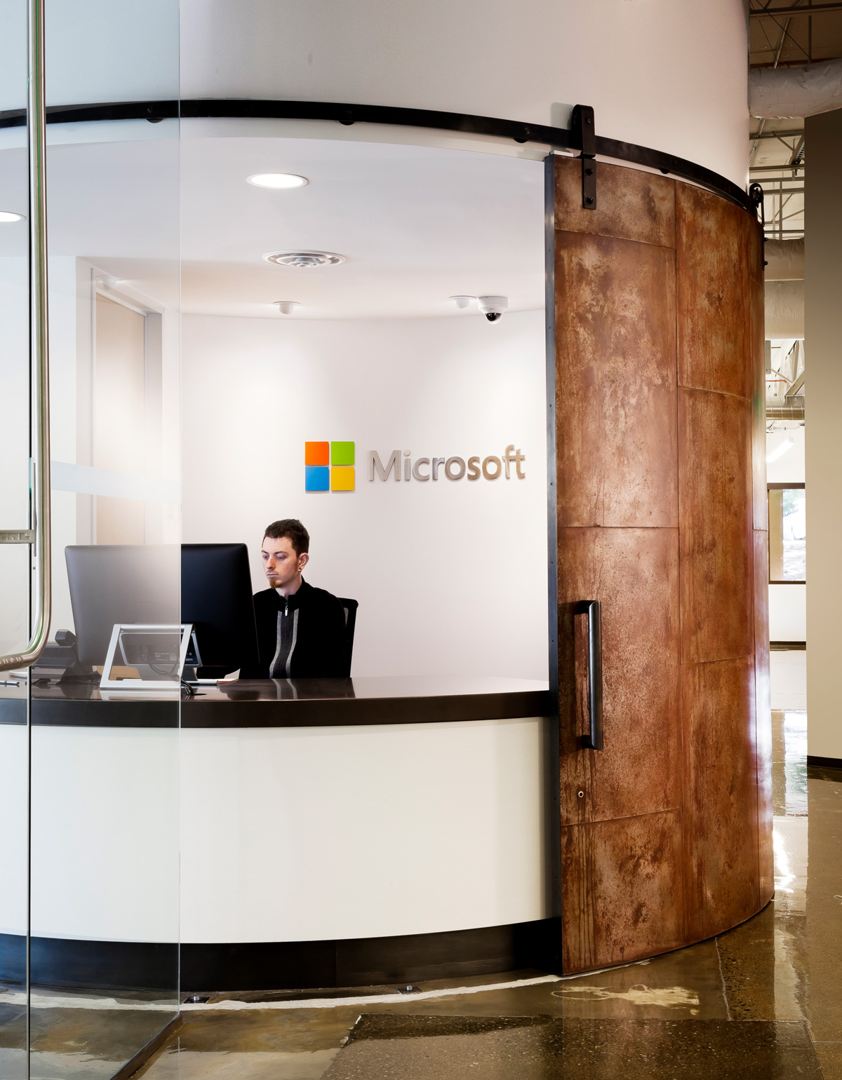 Microsoft B20 Renovation office lobby reception desk with sliding reclaimed door