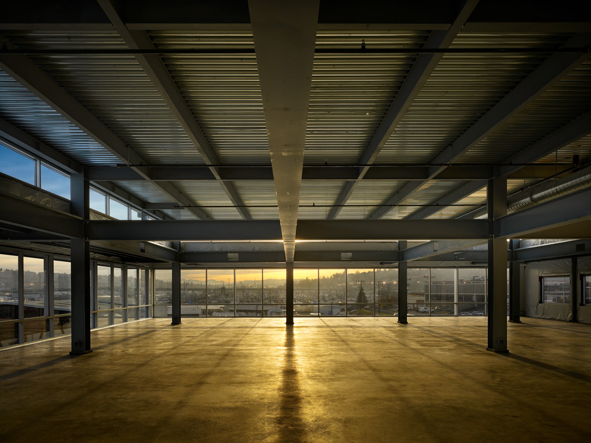 Salmon Bay Landing building, interior support beams at sunset