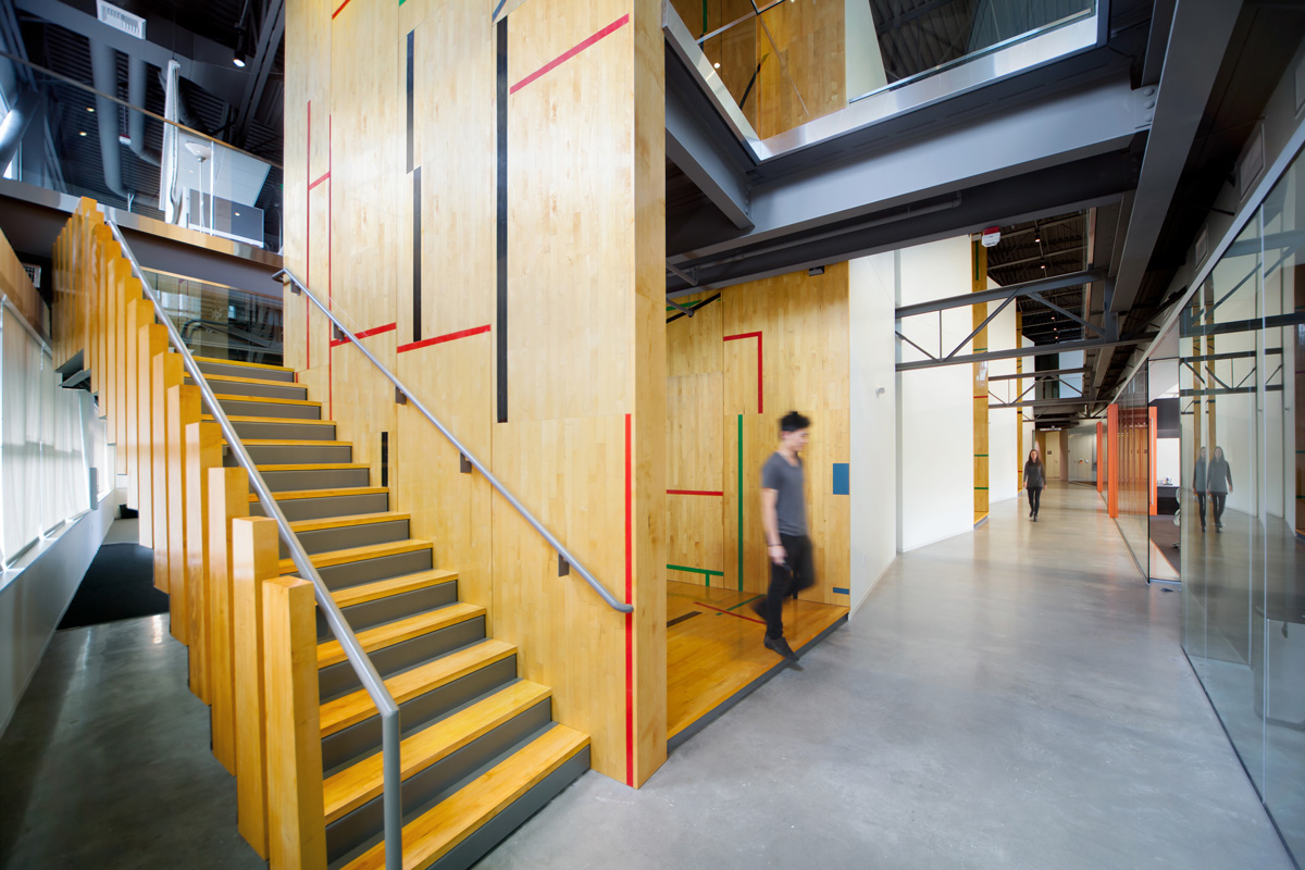 Tableau office reclaimed basketball court hallway and staircase